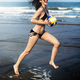 Woman is running at the beach - PhotoDune Item for Sale