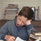 Sleepy Boy Entertains Himself While Doing Homework - VideoHive Item for Sale