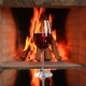 Wineglass with Red Wine Near a Fireplace - VideoHive Item for Sale