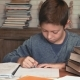 Little Boy Comes Up with a Solution for the Problem While Doing Homework - VideoHive Item for Sale