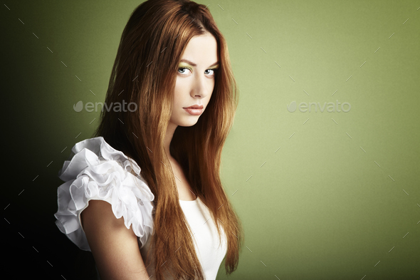 Fashion photo of a young woman with red hair - Stock Photo - Images