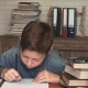 Little Boy Distracted by the Smartphone from Doing Homework - VideoHive Item for Sale