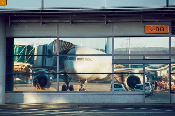Airport reflections during sunny day - Stock Photo - Images