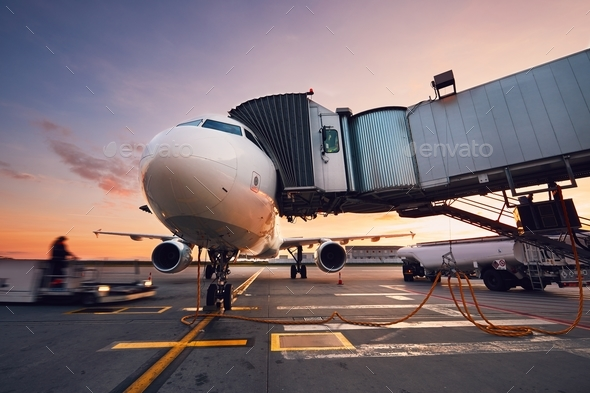 Busy airport at the colorful sunset - Stock Photo - Images