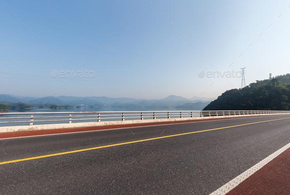 road on lake - Stock Photo - Images