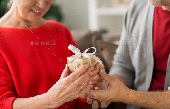 close up of senior couple with christmas gift - Stock Photo - Images