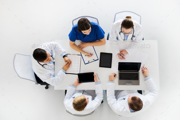 doctors with cardiogram and computers at hospital - Stock Photo - Images