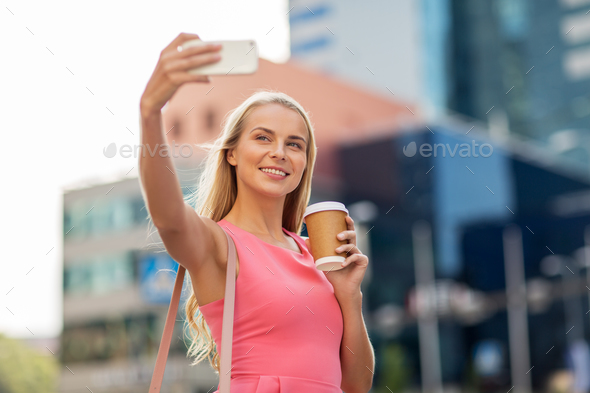woman with coffee taking selfie by smartphone - Stock Photo - Images