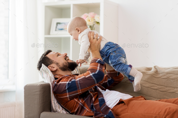 happy father with little baby boy at home - Stock Photo - Images