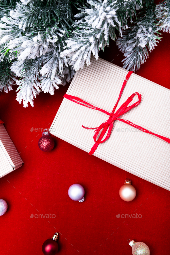 christmas gift box christmas presents in craft boxes and red ribbon on red background flat lay stock photo by bondarillia https photodune net item christmas gift box christmas presents in craft boxes and red ribbon on red background flat lay 20909482