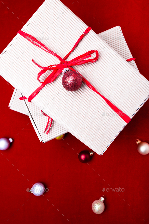 Christmas Boxes.Christmas Gift Box Christmas Presents In Craft Boxes And Red Ribbon On Red Background Flat Lay