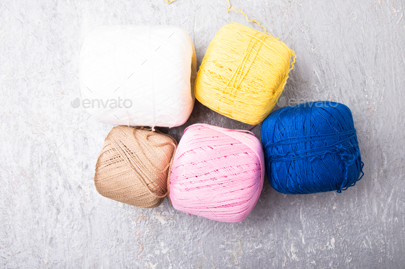 Multicolor knitting ball and needles on grey background - Stock Photo - Images