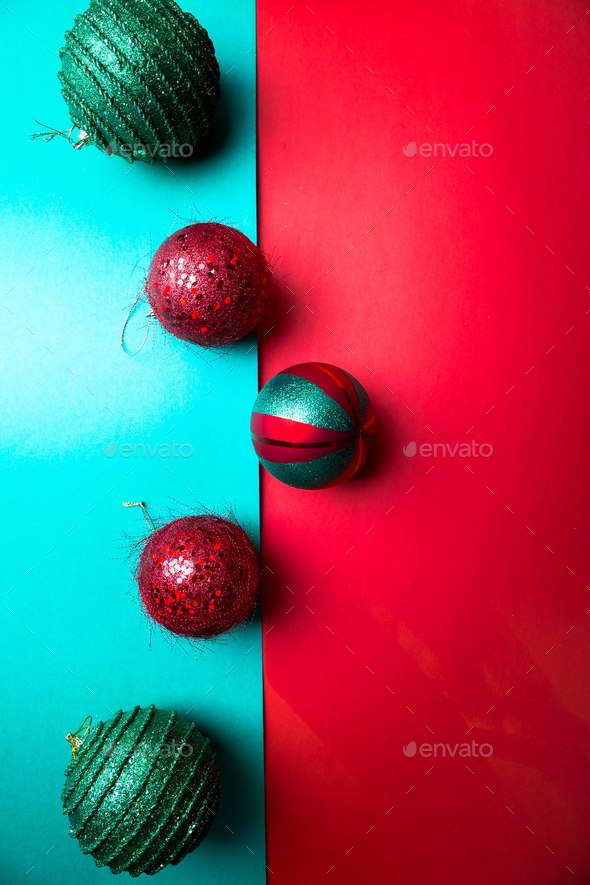 Christmas ball on green and red pepper backround. - Stock Photo - Images