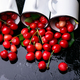Scattered cherry from enamel cups. - PhotoDune Item for Sale