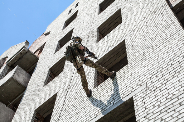 rappeling with weapons - Stock Photo - Images