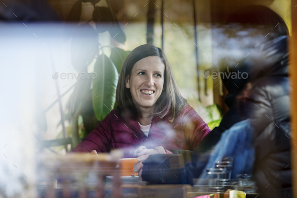 Two people enjoying coffee together in a cafeteria - Stock Photo - Images