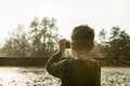 Boy photographing nature with a compact camera