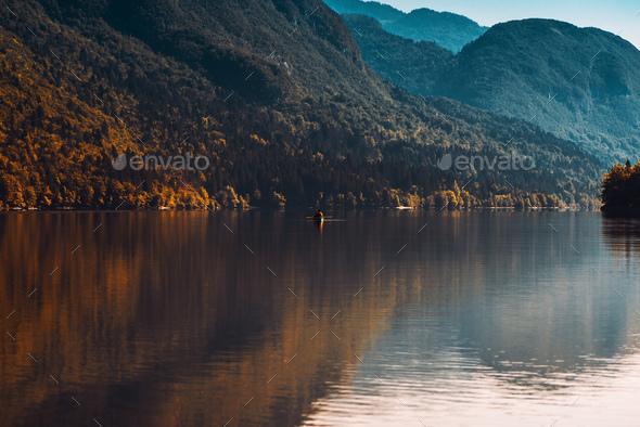 Man rowing boat on Lake Bohinj - Stock Photo - Images