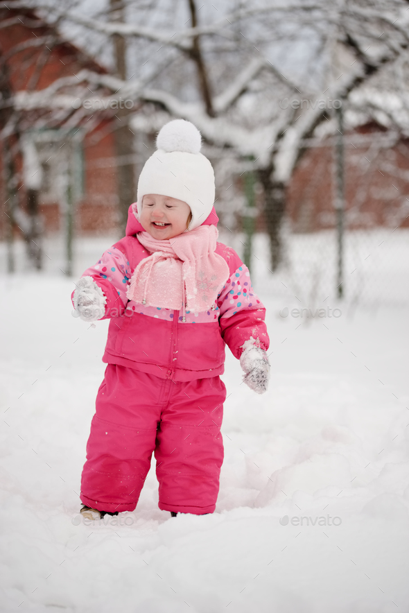 cute girl saw snow first time - Stock Photo - Images