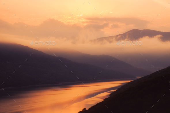 Colorful sunrise landscape view of Zhinvali lake, Country of Georgia - Stock Photo - Images