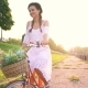 Young Beautiful Woman Riding a Bicycle at Sunset - VideoHive Item for Sale