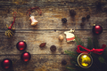 Collection of Christmas gifts and decorative ornaments on wooden background