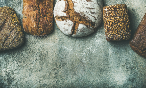 Top view of bread loaves over grey background, copy space - Stock Photo - Images