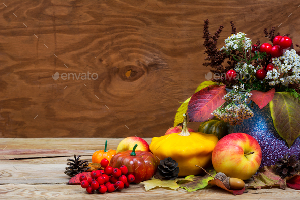 Fall arrangement with red berries, white flowers in purple vase - Stock Photo - Images