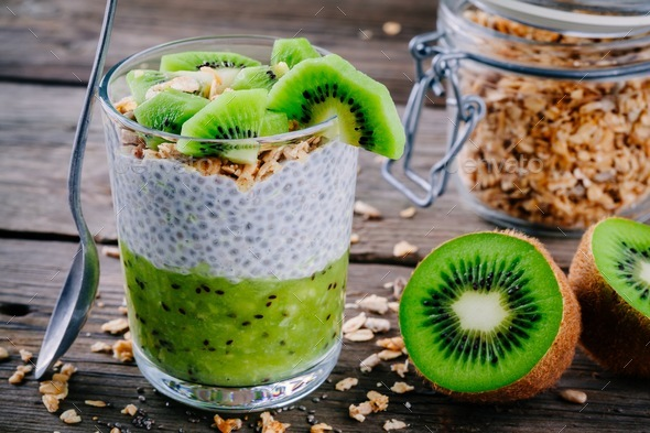 Healthy breakfast. chia pudding with kiwi and granola in glass - Stock Photo - Images