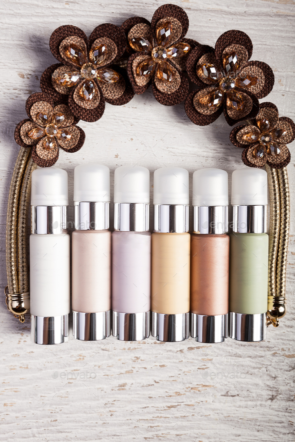 Bottles of cosmetics products over white wooden background - Stock Photo - Images