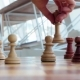 Hand of a Young Girl Makes a Move with a Chess Piece Above the Chessboard in the Room Playing Chess - VideoHive Item for Sale