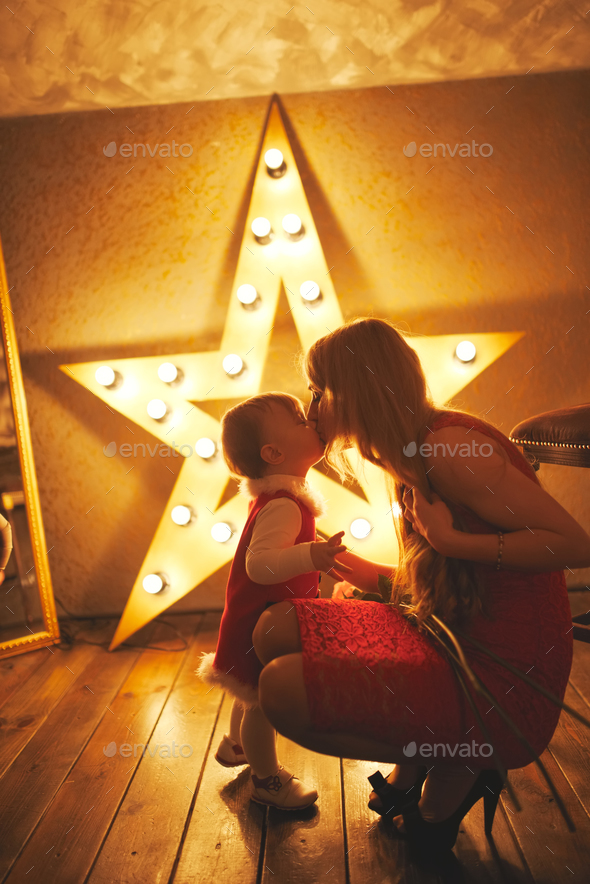cute little kisses her mothe - Stock Photo - Images