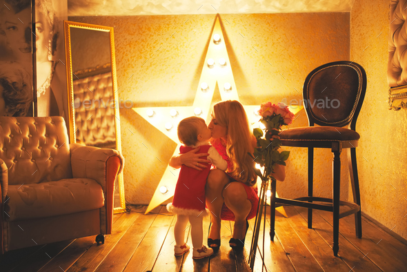 little girl gives her mother bouquet of roses - Stock Photo - Images