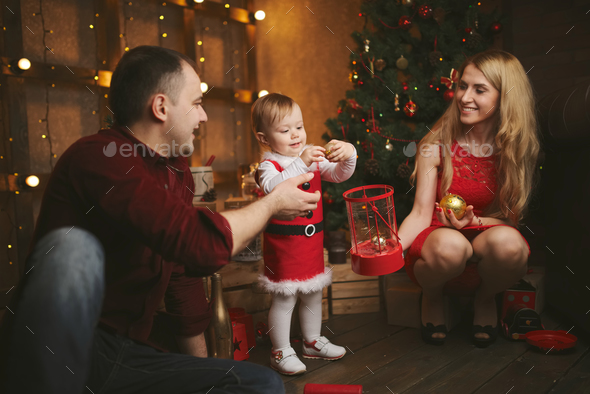 family decorating christmas tree at home - Stock Photo - Images