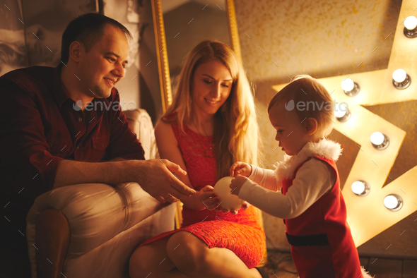 mother and father playing with daughter at home - Stock Photo - Images