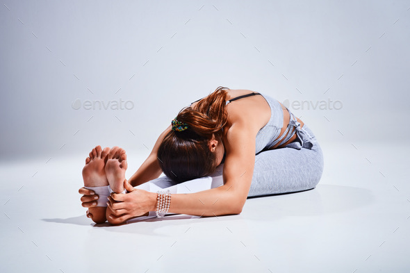 Woman doing yoga isolated on white background - Stock Photo - Images