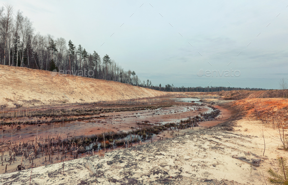 Landscape old waterlogged sand quarry. Environmental pollution - Stock Photo - Images