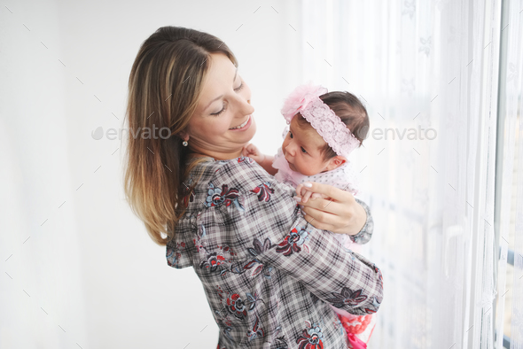young mother with cute newborn baby - Stock Photo - Images