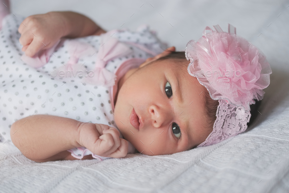 cute newborn girl at home - Stock Photo - Images