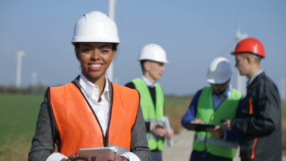 VideoHive Woman with Protective Helmet Against Wind Turbine 20919843