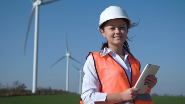 VideoHive Smiling Female Engineer Standing Against Wind Farm 20919941