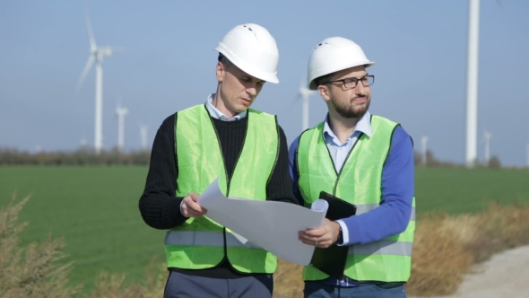 VideoHive Two Engineers Discussing Against Wind Farm 20920135