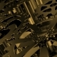 Rotating Golden Gears Movement of Metal Gears in a Mechanical Device - VideoHive Item for Sale
