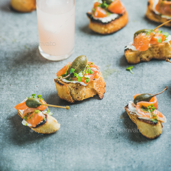 Crostini with smoked salmon and grapefruit cocktails, square crop - Stock Photo - Images