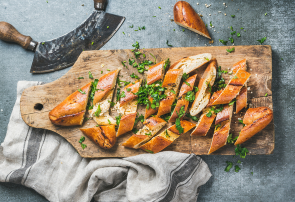 Turkish pizza pide with cheese and spinach chopped in slices - Stock Photo - Images