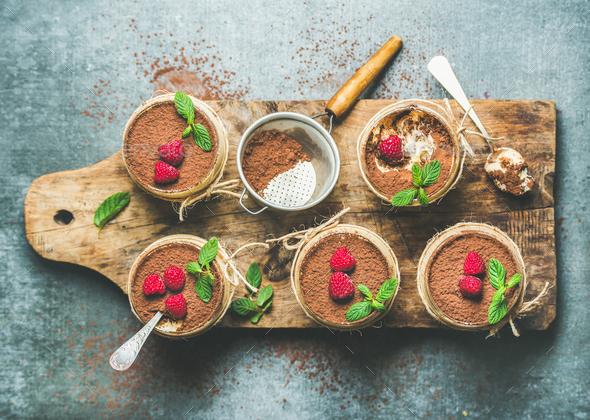 Homemade dessert Tiramisu in glasses on wooden board - Stock Photo - Images