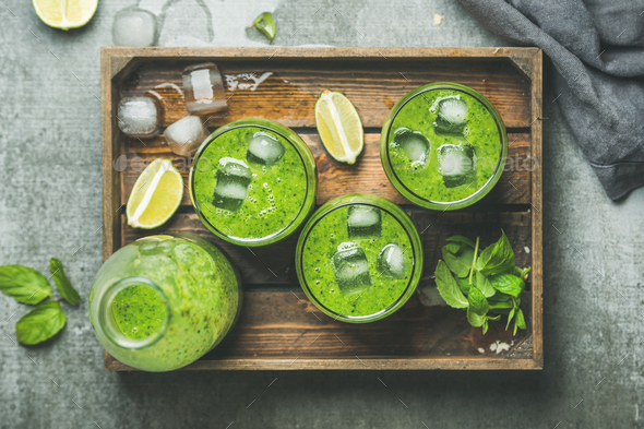 Fresh green smoothie with ice cubes, mint, lime in tray - Stock Photo - Images