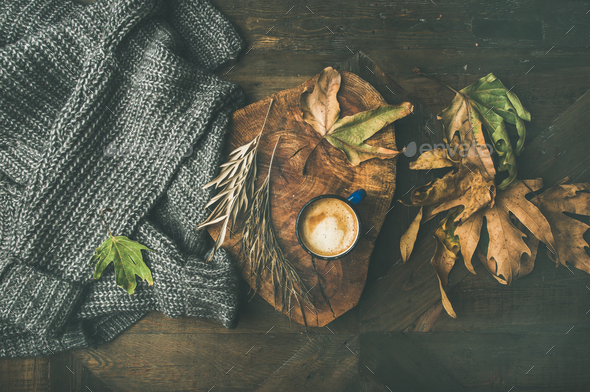 Autumn morning coffee concept with leaves and grey sweater - Stock Photo - Images