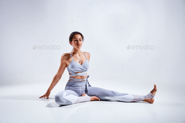 Woman doing yoga isolated on white background - Stock Photo - Images