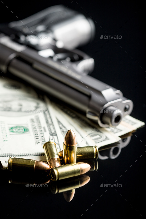 9 mm bullets, dollars and handgun. - Stock Photo - Images